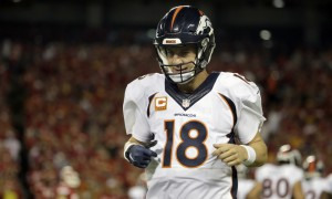 Denver Broncos quarterback Peyton Manning (18) runs off the field during the first half of an NFL football game against the Kansas City Chiefs in Kansas City, Mo., Thursday, Sept. 17, 2015. (AP Photo/Charlie Riedel) ORG XMIT: MONH1