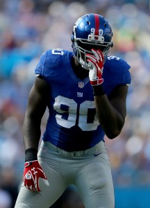 CHARLOTTE, NC - SEPTEMBER 22: Jason Pierre-Paul #90 of the New York Giants during their game at Bank of America Stadium on September 22, 2013 in Charlotte, North Carolina. (Photo by Streeter Lecka/Getty Images)